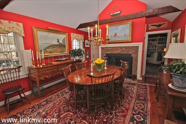 Dining Room w/Fireplace & windows to gardens