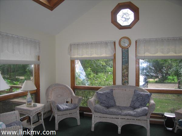 Sunroom with cathedral ceiling