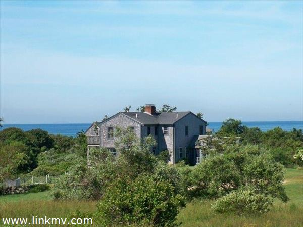 View of the farmhouse and ocean beyond!