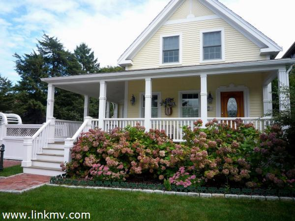 front of house with colorful landscaping