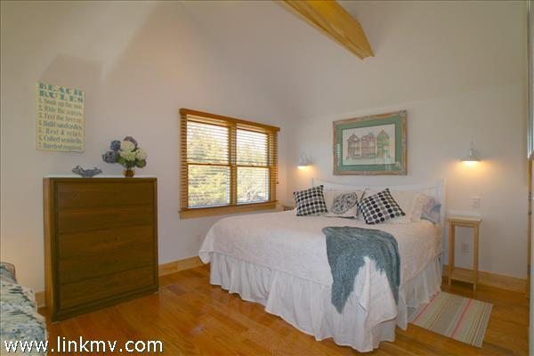 The Guest House Bedroom Area is home to a King Size Bed.