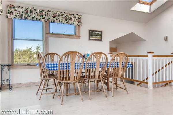 Dining area overlooking the deck with water views.