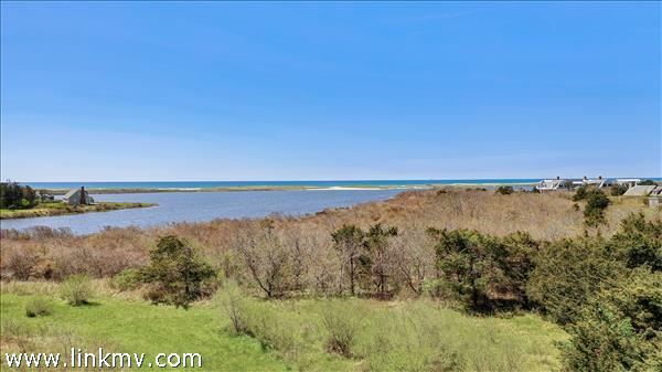 View from the building envelope for a potential four bedroom home with expansive pond and Atlantic views.