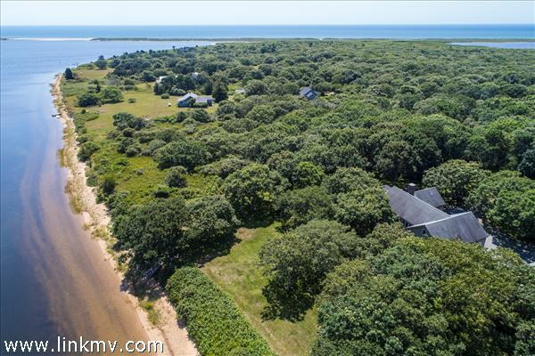This lovely Chilmark property has pond frontage on Tisbury Great Pond as well as views of and access to the Atlantic.