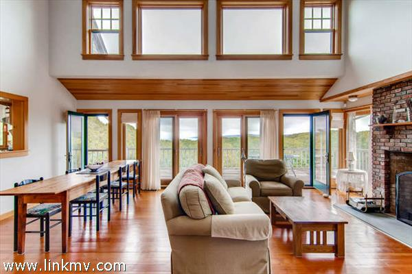 Aquinnah waterview home greatroom opens to expansive deck