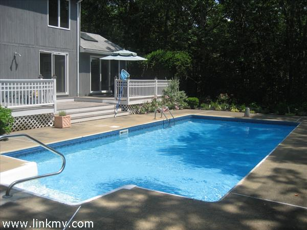 Back yard pool, gardens and deck
