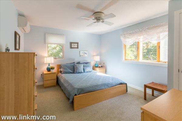 Bright, cheery guest bedroom on second floor.