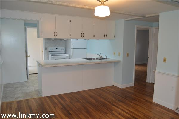 Kitchen off breezeway, open to dining