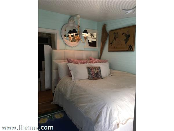 walk thru bedroom, bead-board walls and ceiling