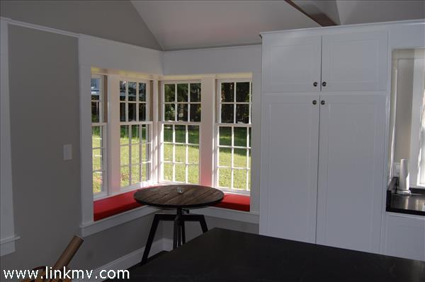 Breakfast Nook in Kitchen With Sunny Bay Windows