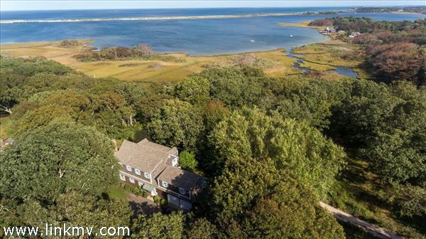 Ariel view of home/property and Sengekontacket Pond beyond
