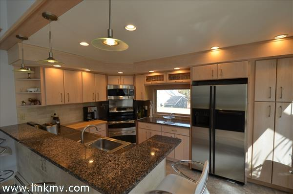 Bright kitchen with new appliances and granite counters