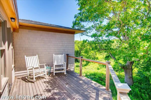 Peaceful deck off master bedroom has it's own outdoor shower.