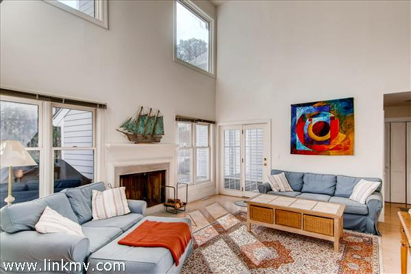The cathedral ceilings in the living room add to the feeling of spaciousness in this charming Martha's Vineyard condominium.