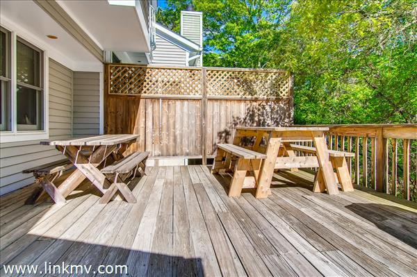 The back deck at the Tashmoo Woods condo looks out over a peaceful wooded area.