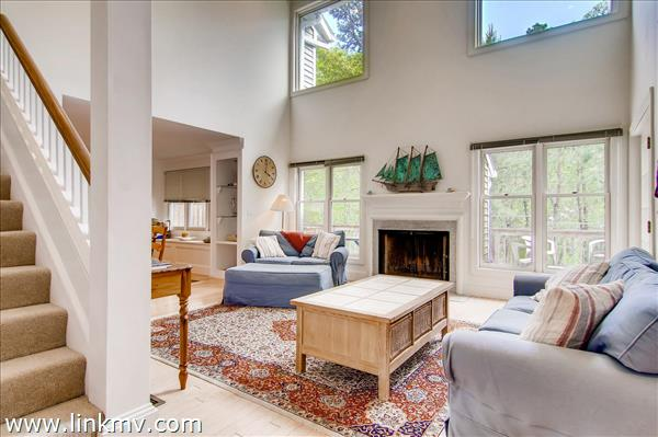 Large open living room with large windows and door onto the back deck allows for generous natural light.