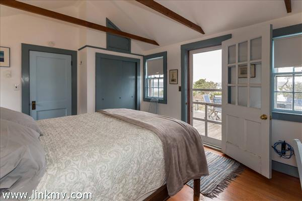 main cottage bedroom with access to exterior deck