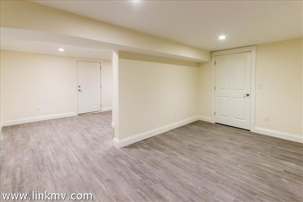 two rooms finished with tile floors, lower level.