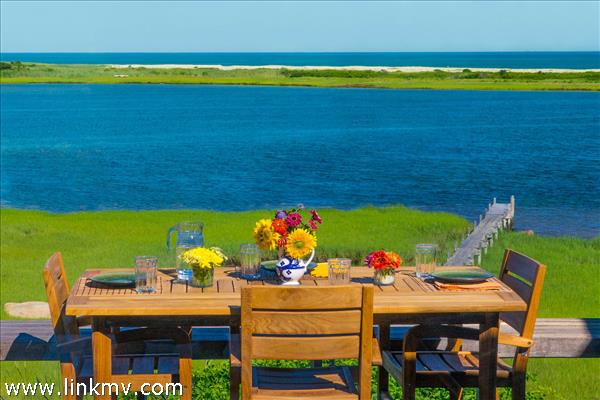 Enjoy al fresco dining on the water facing deck.