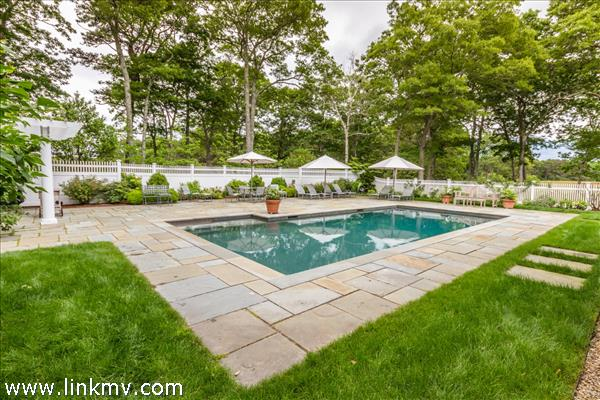 The luxury of a large pool and surrounding space for lounging.