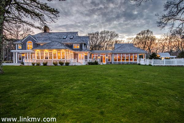 A prestigious home in a remarkable setting. This is the back of the house in the evening.