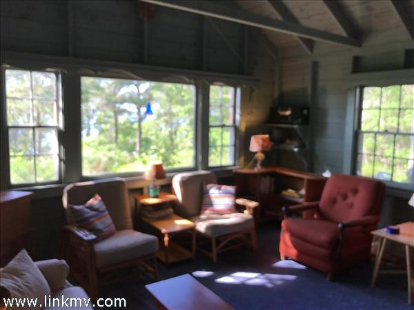 Windows on three sides fill the living room with light