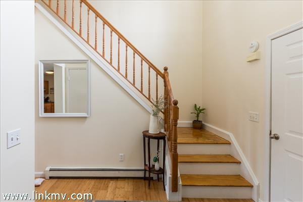 Sunny bright entryway with lovely hardwood floors
