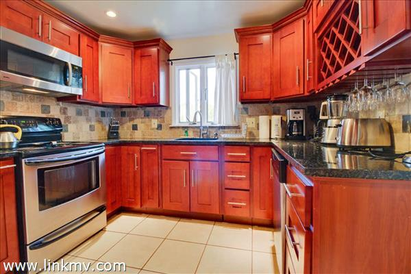 Newly renovated kitchen with stainless appliances.