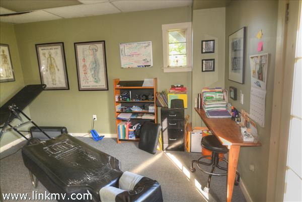 Back office is set up as a 2 room boutique chiropractors office