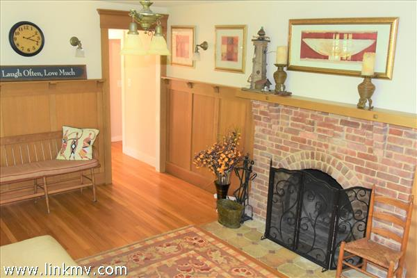 notice classic wainscoting woodwork in living room