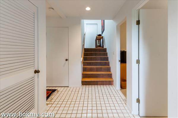 Stairway from foyer to the lower level.