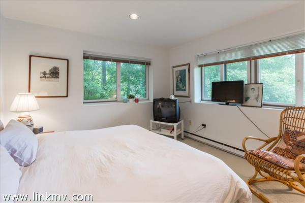 Second guest bedroom on the left with many windows to capture the natural light.