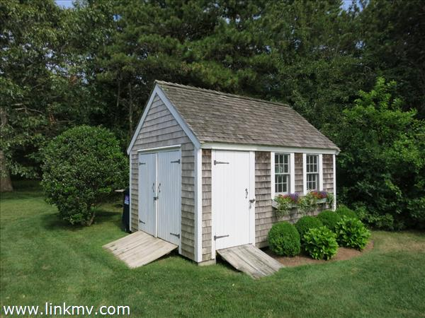 10 X 14 shed with shingled wood roof.