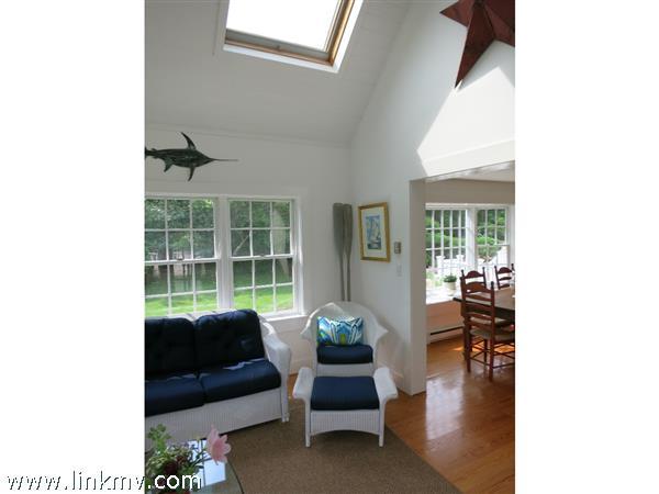 Sunroom looking towards dinning room. New skylights and wood ceiling. 12 X14