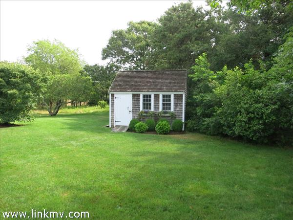 Garden shed with double doors and single door.