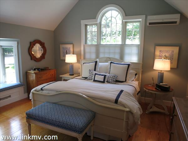 Master bedroom with bay window seat and cathedral ceilings. 15 X 17