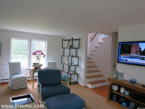 Living room TV and second floor stairs