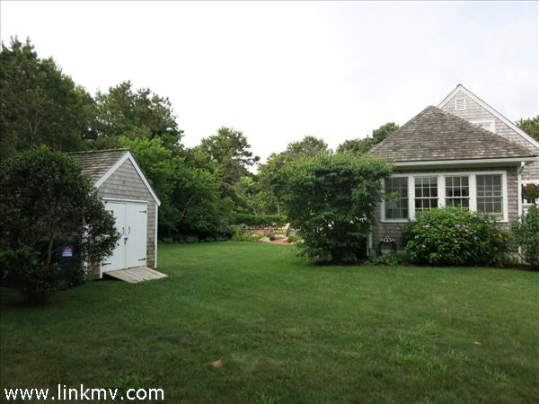 View of back of house and shed toward driveway.