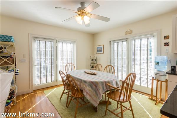 Sun filled dining room with french doors to the outdoor shower, deck and hot tub.