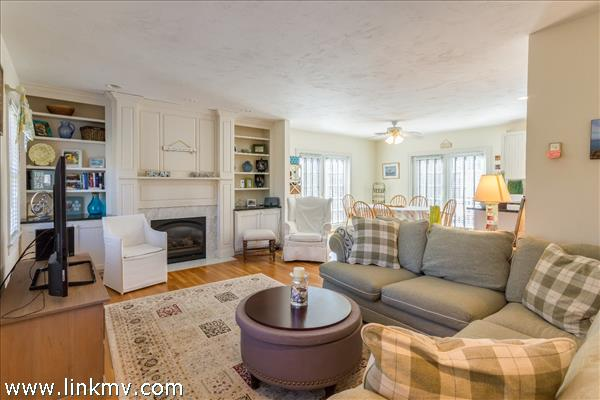 Spacious bright living room with gas fireplace for those chilly evenings.
