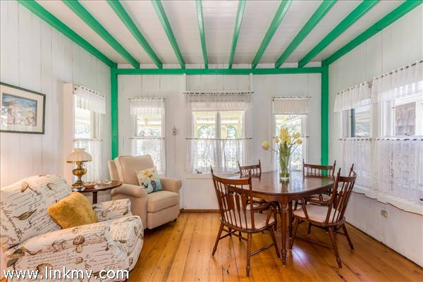 Sunny front parlor set up for dining