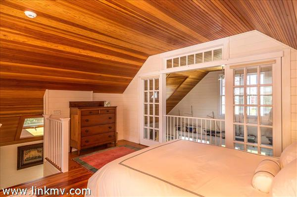 Guest House - Open Loft Bedroom Has Wood Slat Vaulted Ceilings and Overlooks First Floor Open Living Area