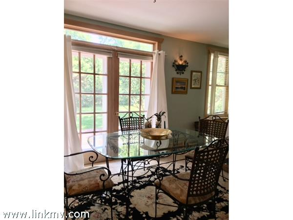 Dining Area overlooks large lawn & gardens.