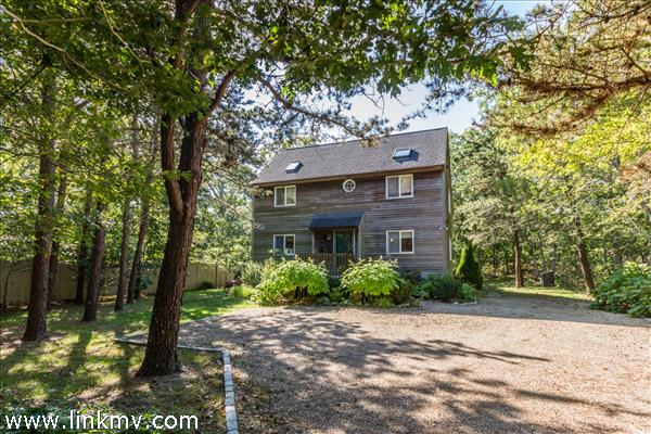 Classic saltbox in a pleasant neighborhood tucked on a private lot.