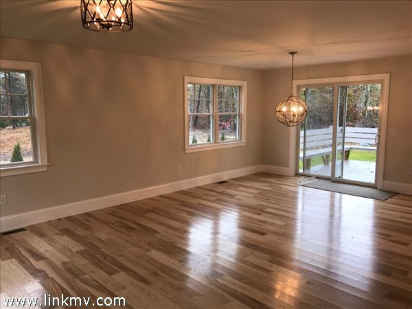 Open concept living with beautiful wood floors.