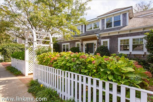 Curb appeal with mature plantings and front yard.