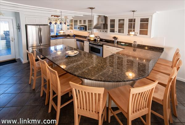 Kitchen with granite counter top breakfast bar