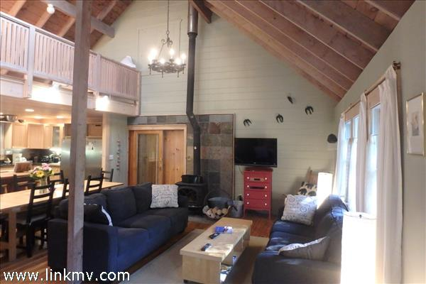 Main Living room with soaring ceilings and loft