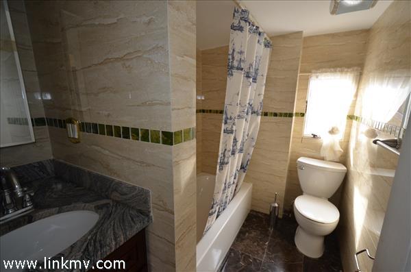 2nd floor full tiled bathroom
