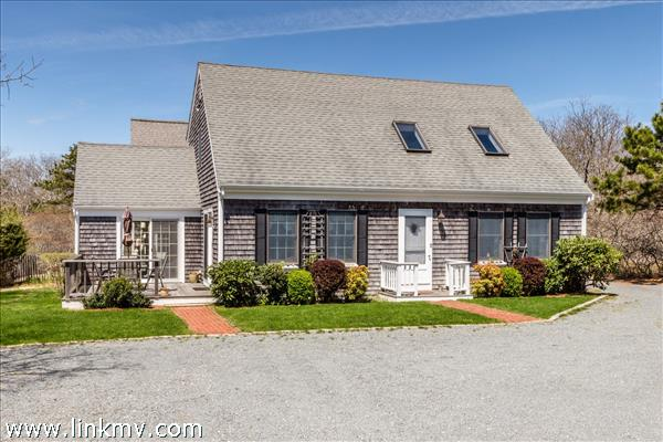 Inviting entrance to this well maintained Cape style home.